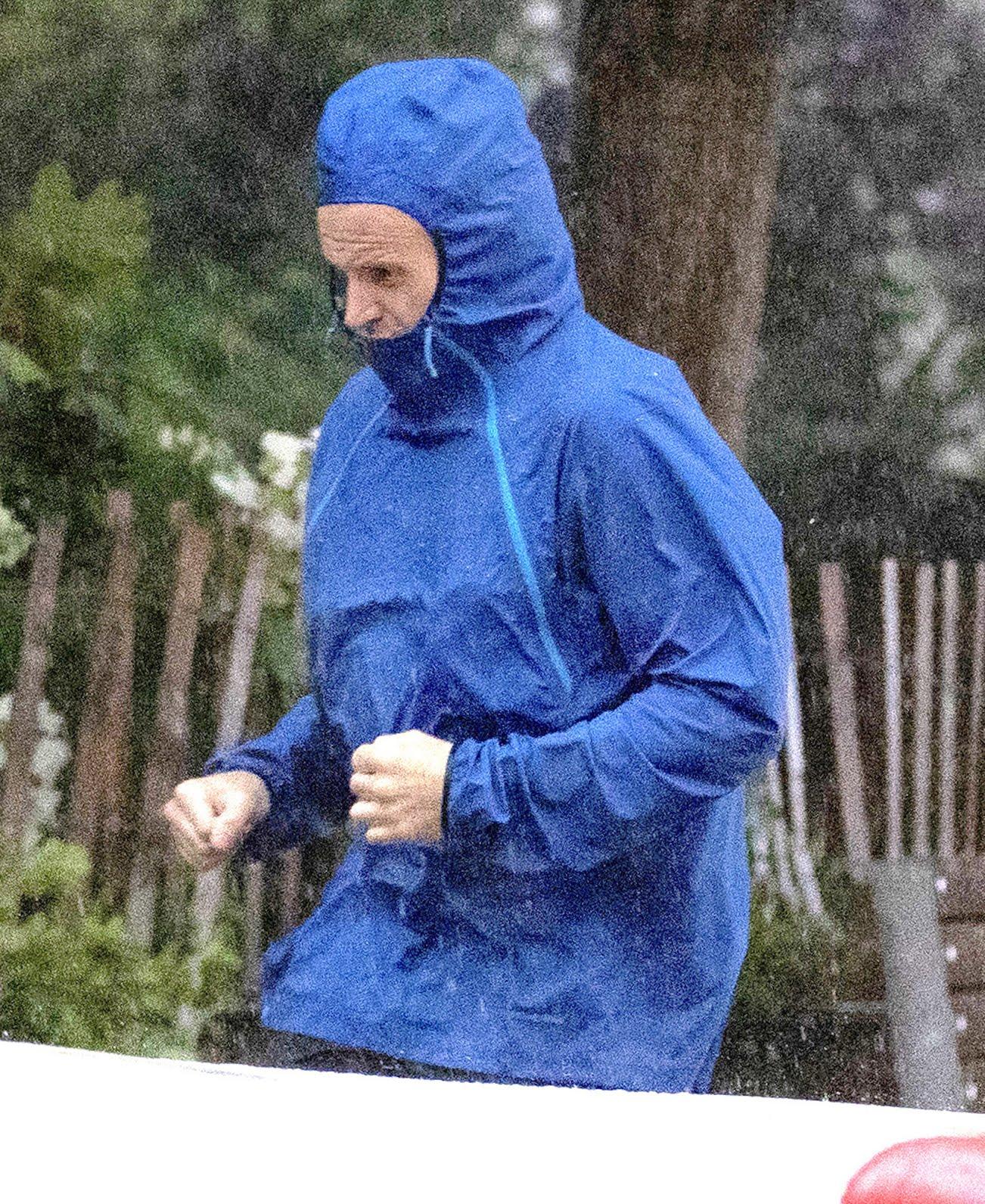 Jonny Lee Miller jogging in the rain